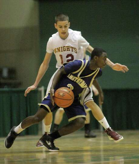 Dwayne Freeman  of Bishop Gibbons, left, defends against Billy Carr  of Amsterdam  during their Clas