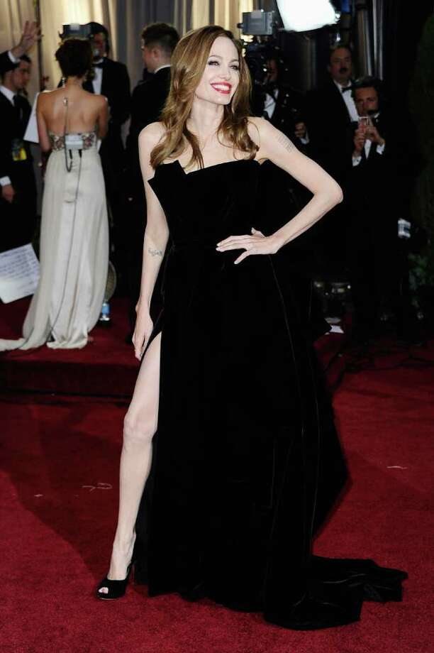 Angelina Jolie's sexy, wild style returned. This black number had so many people talking, her leg earned its own Twitter account. Photo: Frazer Harrison, Getty Images / 2012 Getty Images