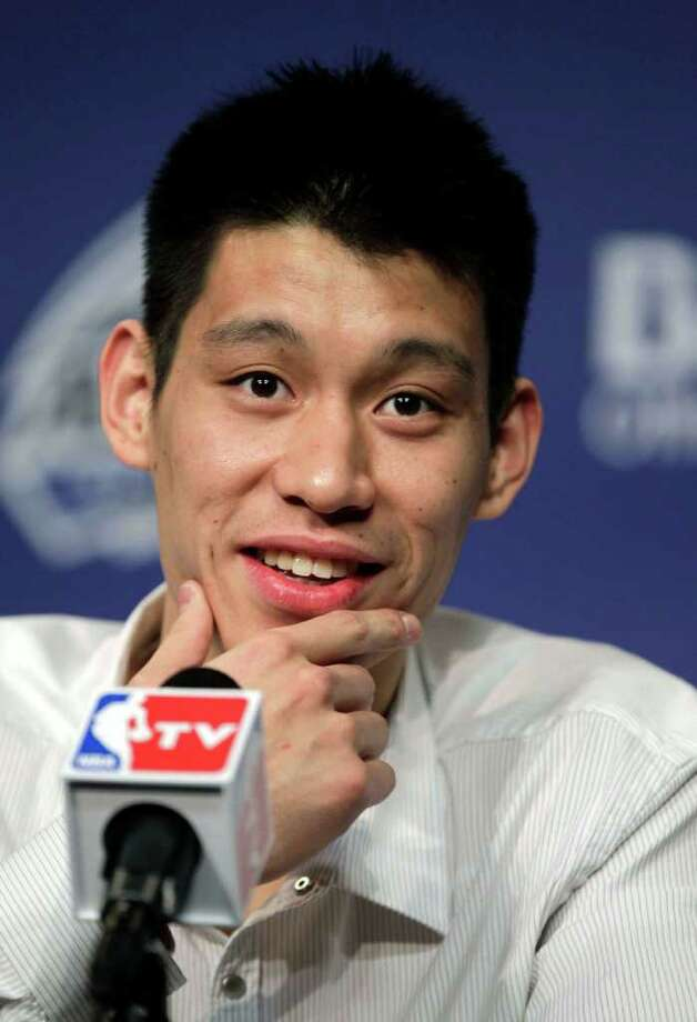 New York Knicks' Jeremy Lin appears for a availability before the NBA All-Star BBVA Rising Stars Challenge basketball game in Orlando, Fla., on  Friday, Feb. 24, 2012. (AP Photo/Chris O'Meara) Photo: Associated Press