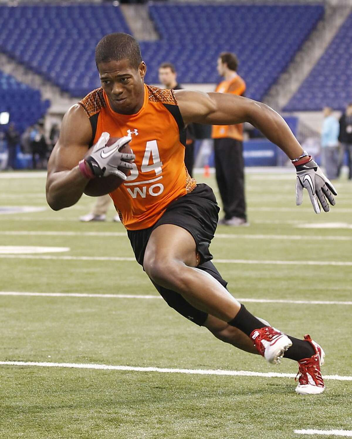 Stanford receiver Chris Owusu runs a drill at the NFL football scouting combine in Indianapolis on Sunday, Feb. 26, 2012. (AP Photo/Dave Martin)