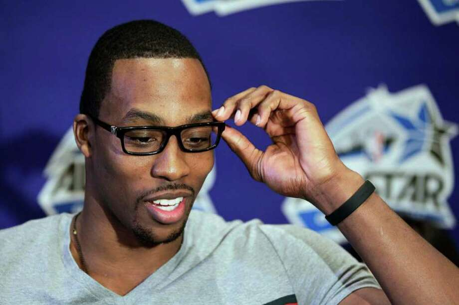 Orlando Magic's Dwight Howard gestures during an NBA All Star basketball player news conference, Friday, Feb. 24, 2012, in Orlando, Fla. The NBA All Star game will be played in Orlando on Sunday. (AP Photo/Chris O'Meara) Photo: Associated Press