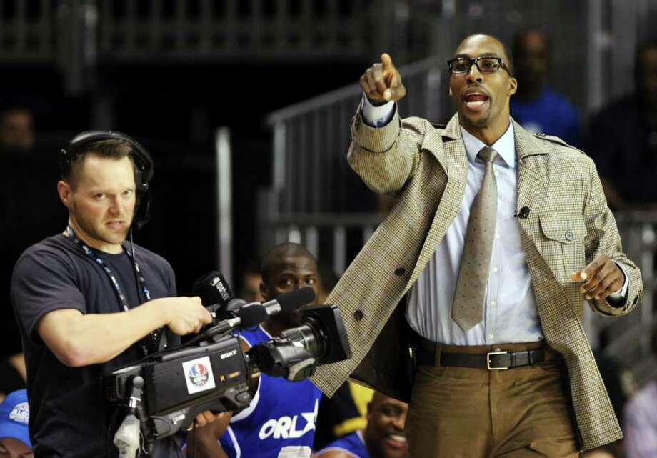 Orlando Magic's Dwight Howard yells as he coaches during the NBA All-Star celebrity basketball game, Friday, Feb. 24, 2012, in Orlando, Fla. (AP Photo/Lynne Sladky) Photo: Associated Press