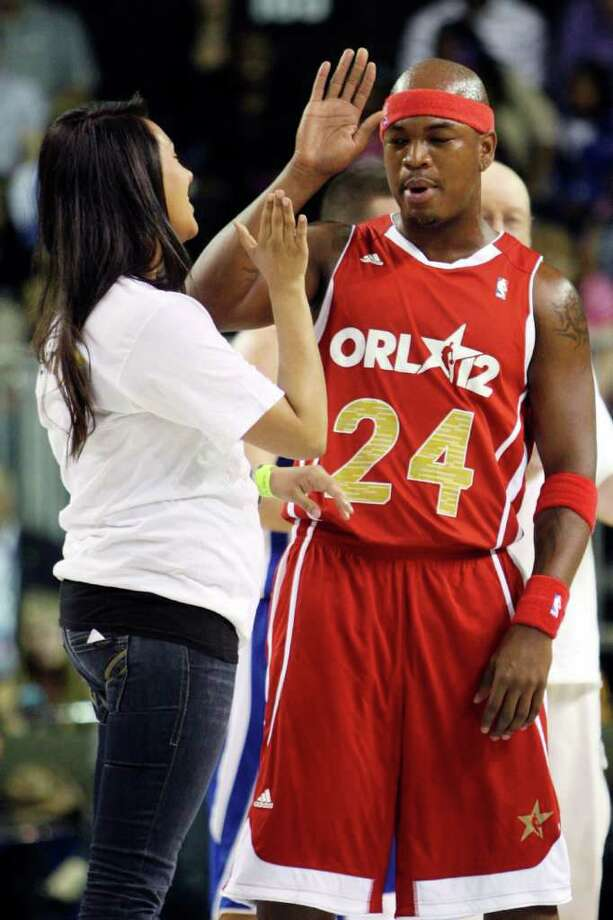 Performer Ne-Yo high-fives a contestant in a dance contest during the NBA All-Star celebrity basketball game, Friday, Feb. 24, 2012, in Orlando, Fla. (AP Photo/Lynne Sladky) Photo: Associated Press