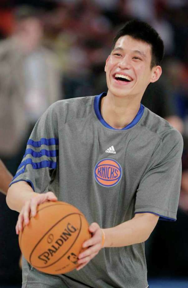 New York Knicks' Jeremy Lin laughs during warmups before the start of the NBA All-Star Rising Stars Challenge basketball game in Orlando, Fla. Friday, Feb. 24, 2012. (AP Photo/Chris O'Meara) Photo: Associated Press