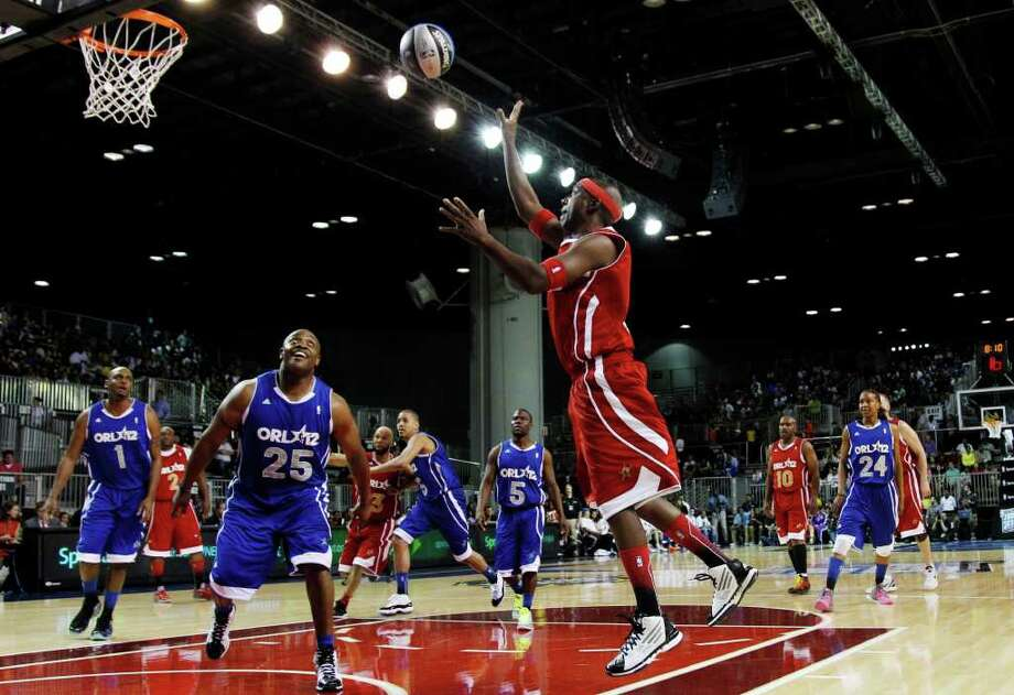 Actor J.B. Smoove, right, shoots during the NBA All-Star celebrity basketball game, Friday, Feb. 24, 2012, in Orlando, Fla. (AP Photo/Lynne Sladky) Photo: Associated Press