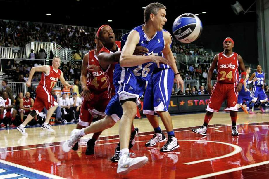United States Secretary of Education Arne Duncan (26) loses control of the ball in front of musician Ne-Yo (24) during the NBA All-Star celebrity basketball game, Friday, Feb. 24, 2012, in Orlando, Fla. (AP Photo/Lynne Sladky) Photo: Associated Press