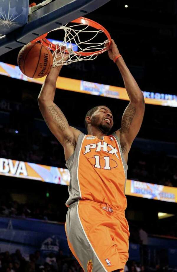 Phoenix Suns' Markieff Morris (11), of Team Shaq, dunks the ball during the NBA All-Star Rising Stars Challenge basketball game in Orlando, Fla. Friday, Feb. 24, 2012. (AP Photo/Chris O'Meara) Photo: Associated Press