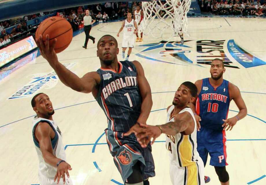 Charlotte Hornets' Kemba Walker (1), of Team Shaq , shoots past Indiana Pacers' Paul George (24), of Team Chuck, during the NBA All-Star Rising Stars Challenge basketball game in Orlando, Fla. Friday, Feb. 24, 2012. (AP Photo/Mike Ehrmann, Pool) Photo: Associated Press