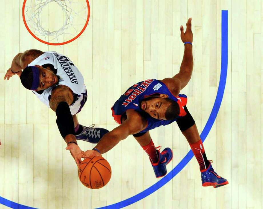 Detroit Pistons' Greg Monroe (15), right, of Team Shaq, and Sacramento Kings' DeMarcus Cousins, of Team Chuck, fight for a rebound during the NBA All-Star Rising Stars Challenge basketball game in Orlando, Fla. Friday, Feb. 24, 2012. (AP Photo/Gary Bogdon, Pool) Photo: Associated Press