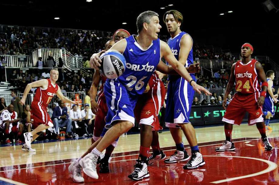 United States Secretary of Education Arne Duncan (26) dribbles the ball downcourt past musician Ne-Yo (24) during the NBA All-Star celebrity basketball game, Friday, Feb. 24, 2012, in Orlando, Fla. (AP Photo/Lynne Sladky) Photo: Associated Press