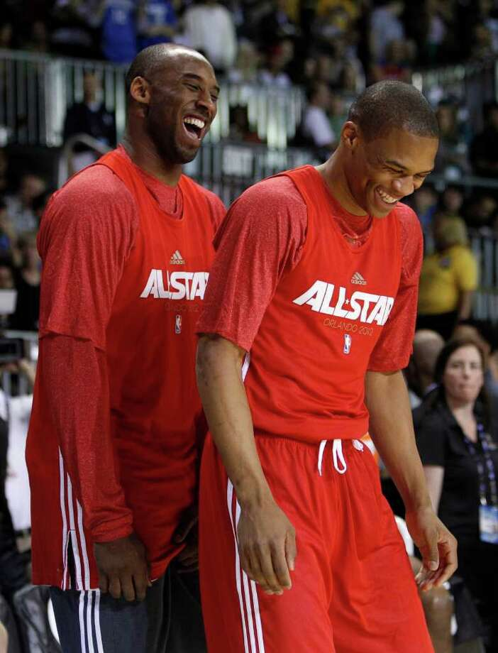 Los Angeles Lakers' Kobe Bryant, left, laughs with Oklahoma City Thunder's Russell Westbrook, right, during practice for the NBA All Star basketball game, Saturday, Feb. 25, 2012, in Orlando, Fla. (AP Photo/Lynne Sladky) Photo: Associated Press