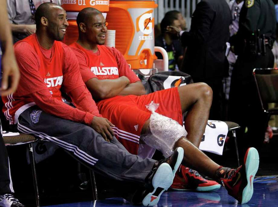 Los Angles Lakers' Kobe Bryant, left, sits with teammate Andrew Bynum, right, during practice for the NBA All Star basketball game, Saturday, Feb. 25, 2012, in Orlando, Fla. (AP Photo/Lynne Sladky) Photo: Associated Press
