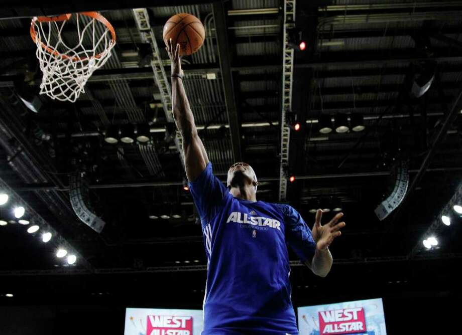 Orlando Magic's Dwight Howard shoots during practice for the NBA All Star basketball game, Saturday, Feb. 25, 2012, in Orlando, Fla. (AP Photo/Lynne Sladky) Photo: Associated Press