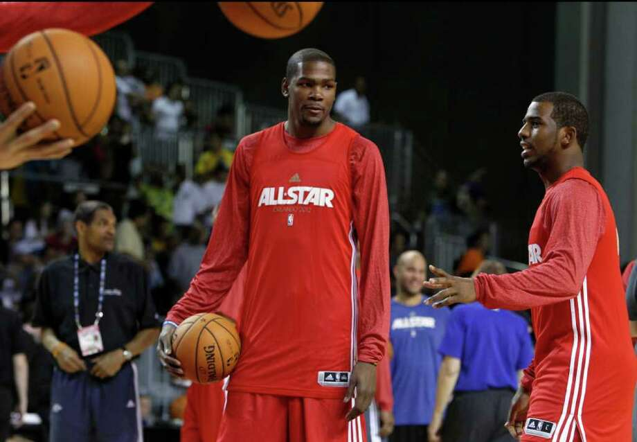 Oklahoma City Thunder's Kevin Durant, left, talks with Los Angeles Clippers Chris Paul, right, during practice for the NBA All Star basketball game, Saturday, Feb. 25, 2012, in Orlando, Fla. (AP Photo/Lynne Sladky) Photo: Associated Press