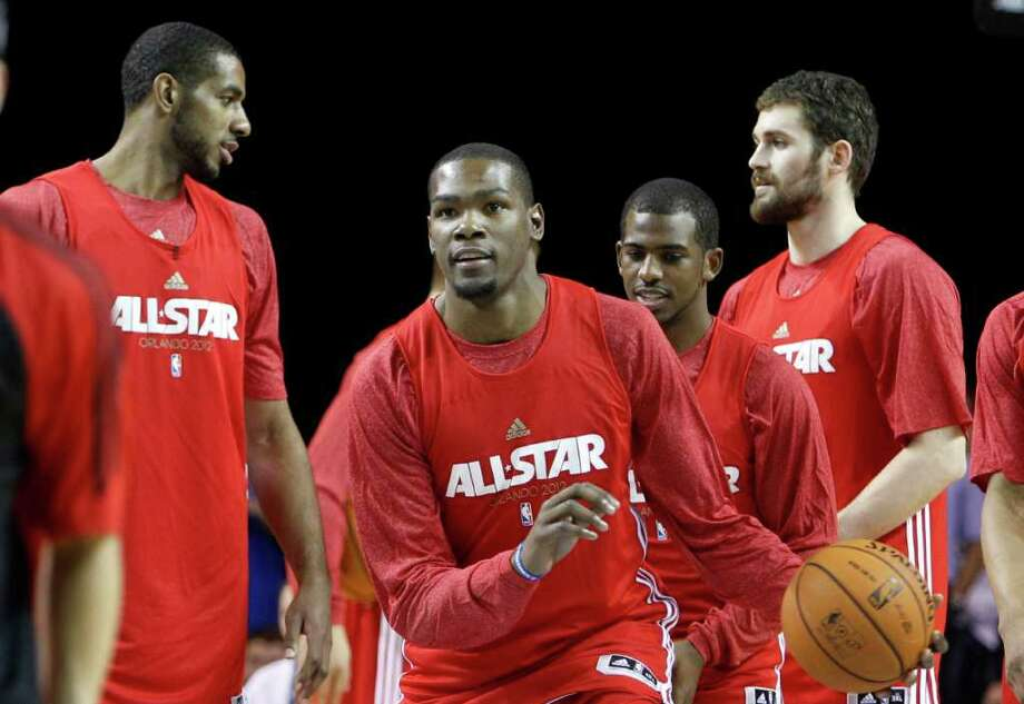 Oklahoma city Thunder's Kevin Durant, center, prepares to shoot during practice for the NBA All Star basketball game, Saturday, Feb. 25, 2012, in Orlando, Fla. (AP Photo/Lynne Sladky) Photo: Associated Press