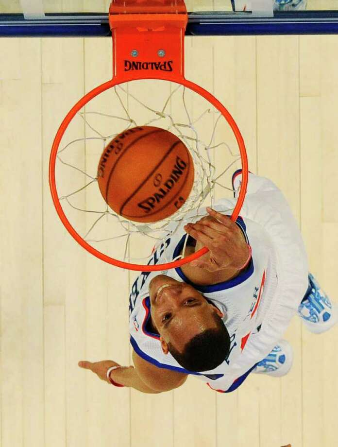 Philadelphia 76ers' Evan Turner, of Team Chuck, dunks the ball during the NBA All-Star Rising Stars Challenge basketball game in Orlando, Fla. Friday, Feb. 24, 2012. Team Chuck defeated Team Shaq 146-133. (AP Photo/Gary Bogdon, Pool) Photo: Associated Press