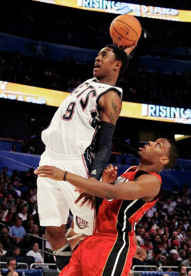 New Jersey Nets' MarShon Brooks (9), of Team Chuck, goes over Miami Heats' Norris Cole, of Team Shaq, during the NBA All-Star Rising Stars Challenge game in Orlando, Fla. Friday, Feb. 24, 2012. (AP Photo/Chris O'Meara) Photo: Associated Press