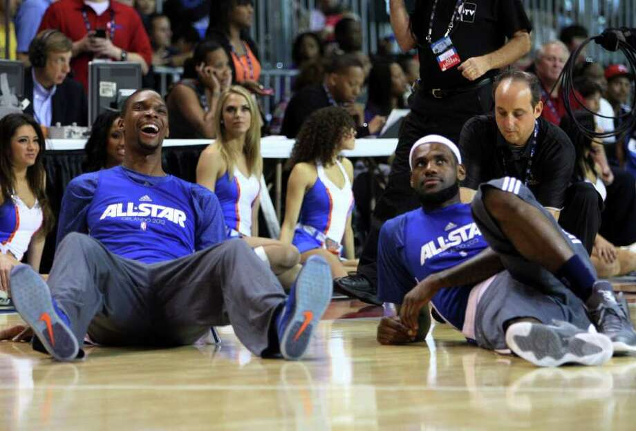 Miami Heat's Chris Bosh, left, sits with LeBron James, right, during practice for the NBA All Star basketball game, Saturday, Feb. 25, 2012, in Orlando, Fla. (AP Photo/Lynne Sladky) Photo: Associated Press