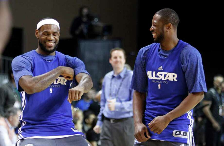 Miami Heat's LeBron James, left, does a dance move as he stands with teammate Dwyane Wade during practice for the NBA All Star basketball game, Saturday, Feb. 25, 2012, in Orlando, Fla. (AP Photo/Lynne Sladky) Photo: Associated Press