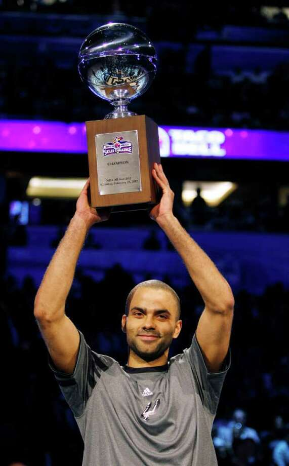San Antonio Spurs' Tony Parker (9) holds the NBA All-Star Skills Challenge basketball competition trophy after winning the event in Orlando, Fla., Saturday, Feb. 25, 2012. (AP Photo/Lynne Sladky) Photo: Associated Press