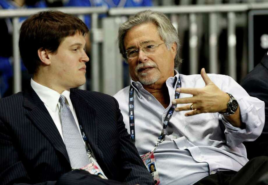 Miami Heat owner Micky Arison, right, sits with his son Nick Arison, CEO of the Heat, left, during practice for the NBA All Star basketball game, Saturday, Feb. 25, 2012, in Orlando, Fla. (AP Photo/Lynne Sladky) Photo: Associated Press