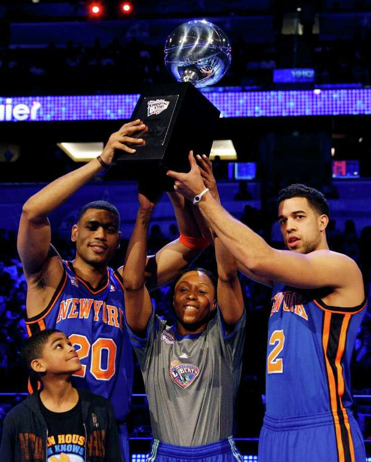 Former New York Knicks guard Allan Houston (20), New York Liberty guard Cappie Pondexter and Knicks guard Landry Fields (2) hold the NBA All-Star Shooting Stars basketball competition trophy in Orlando, Fla., Saturday, Feb. 25, 2012. (AP Photo/Lynne Sladky) Photo: Associated Press