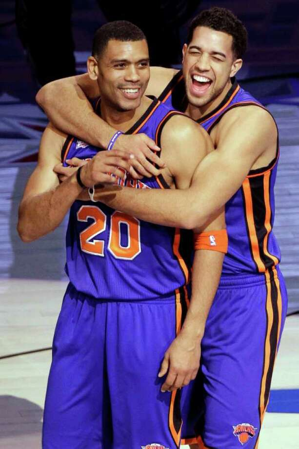 New York Knicks guard Landry Fields, right, hugs former Knicks guard Allan Houston (20) after winning the NBA All-Star Shooting Stars basketball competition in Orlando, Fla., Saturday, Feb. 25, 2012. (AP Photo/Chris O'Meara) Photo: Associated Press