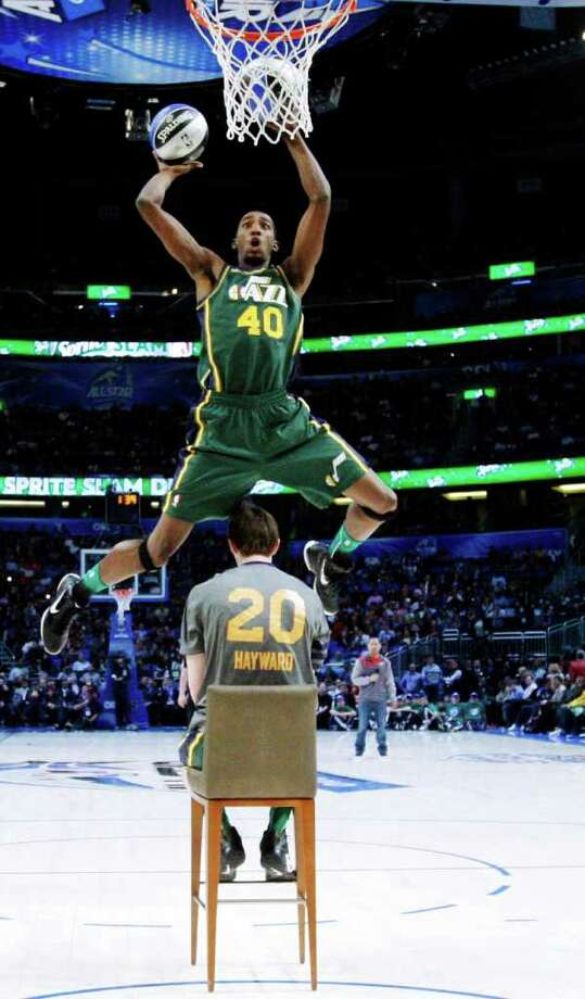 Utah Jazz's Jeremy Evans jumps over teammate Gordon Hayward during the NBA basketball All-Star Slam Dunk Contest in Orlando, Fla., Saturday, Feb. 25, 2012. (AP Photo/Jeff Haynes, Pool) Photo: Associated Press