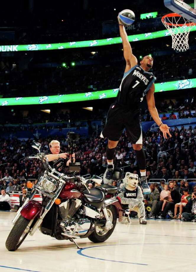 Minnesota Timberwolves' Derrick Williams jumps over a motorcycle during the NBA basketball All-Star Slam Dunk Contest in Orlando, Fla., Saturday, Feb. 25, 2012. (AP Photo/Lynne Sladky) Photo: Associated Press
