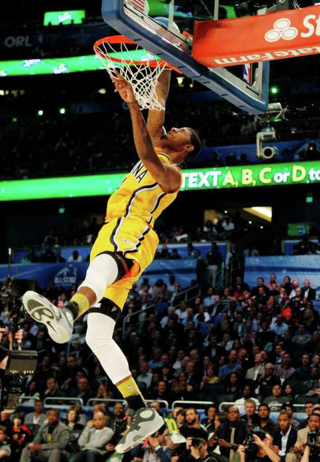 Indiana Pacers' Paul George dunks during the NBA basketball All-Star Slam Dunk contest, Saturday, Feb. 25, 2012, in Orlando, Fla. (AP Photo/Lynne Sladky) Photo: Associated Press
