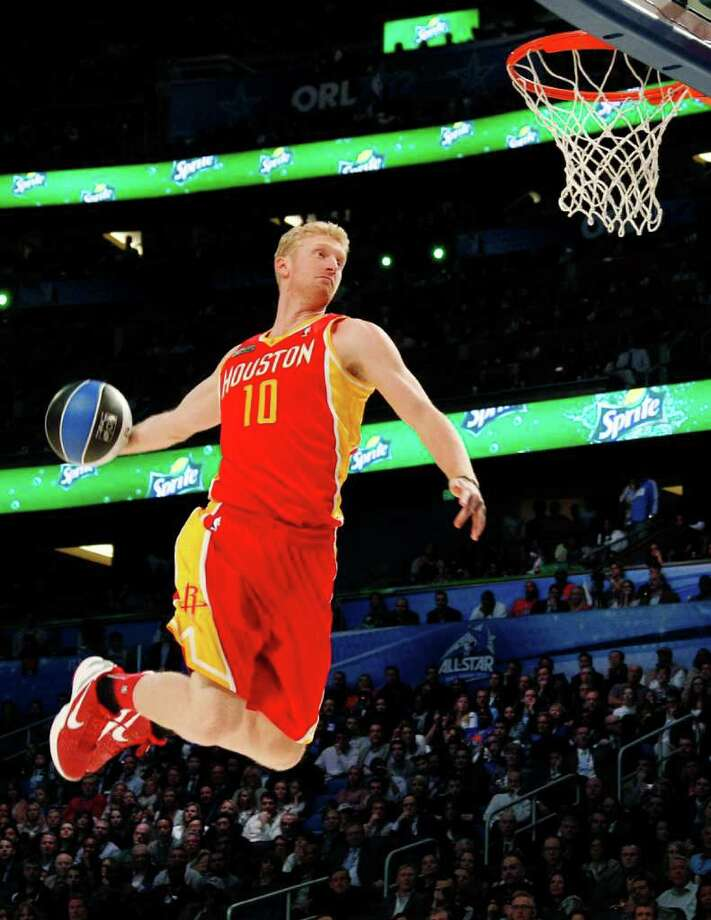 Houston Rockets' Chase Budinger (10) performs his attempt during the NBA basketball All-Star Slam Dunk Contest in Orlando, Fla., Saturday, Feb. 25, 2012. (AP Photo/Lynne Sladky) Photo: Associated Press