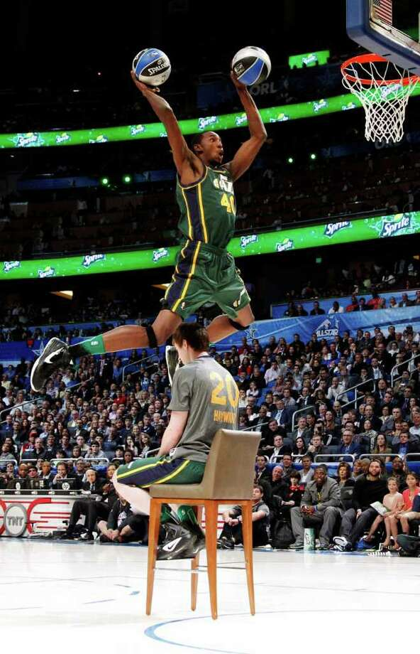 Utah Jazz's Jeremy Evans jumps over teammate Gordon Hayward for his attempt during the NBA basketball All-Star Slam Dunk Contest in Orlando, Fla., Saturday, Feb. 25, 2012. Evans earned 29 percent of 3 million text message votes cast by fans to win the competition. (AP Photo/Lynne Sladky) Photo: Associated Press