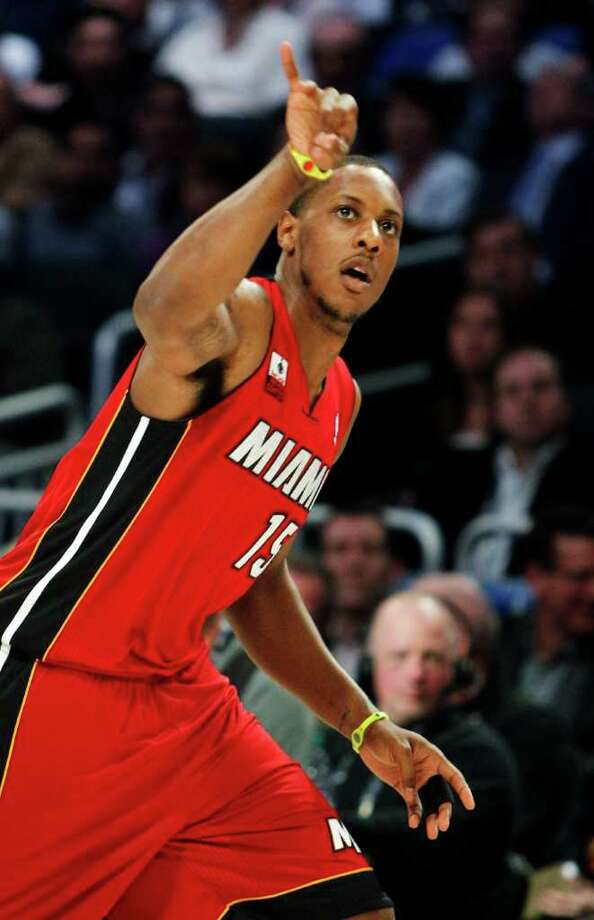 Miami Heat's Mario Chalmers gestures during the NBA All-Star Three-Point Shootout basketball competition in Orlando, Fla., Saturday, Feb. 25, 2012. (AP Photo/Lynne Sladky) Photo: Associated Press