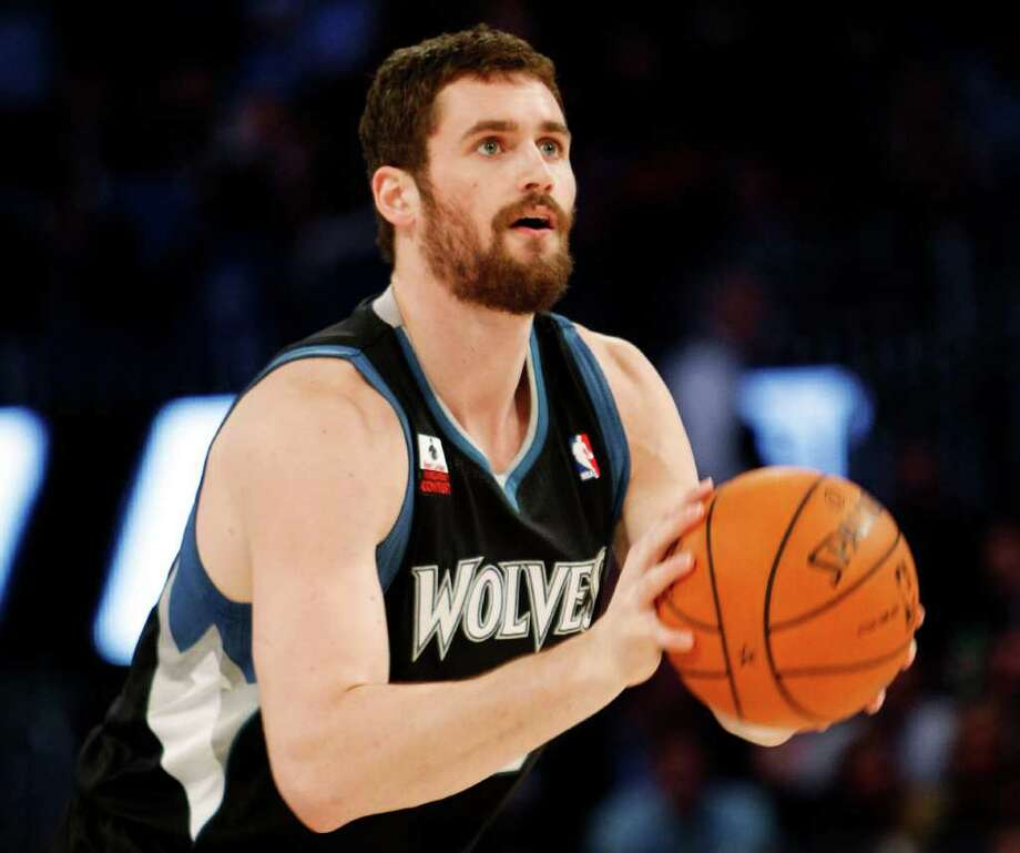 Minnesota Timberwolves' Kevin Love shoots during the NBA All-Star Three-Point Shootout basketball competition in Orlando, Fla., Saturday, Feb. 25, 2012. (AP Photo/Lynne Sladky) Photo: Associated Press