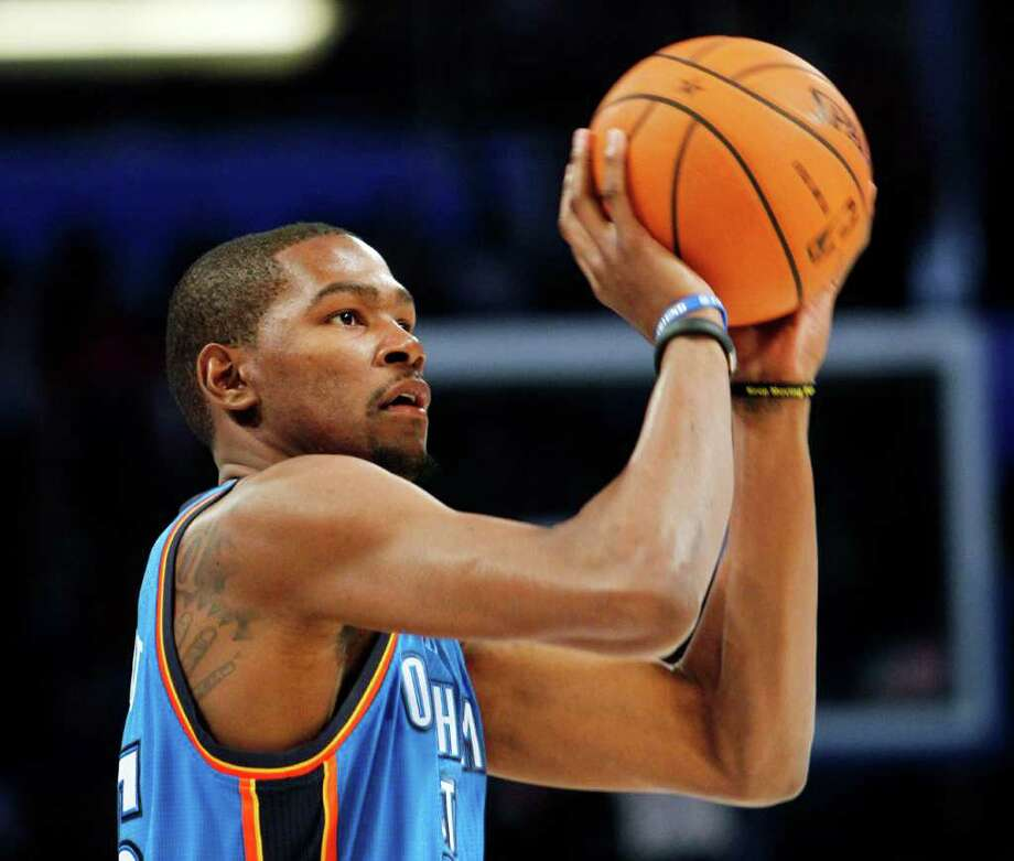 Oklahoma City Thunder's Kevin Durant shootss during the NBA All-Star Three-Point Shootout basketball competition in Orlando, Fla., Saturday, Feb. 25, 2012. (AP Photo/Lynne Sladky) Photo: Associated Press