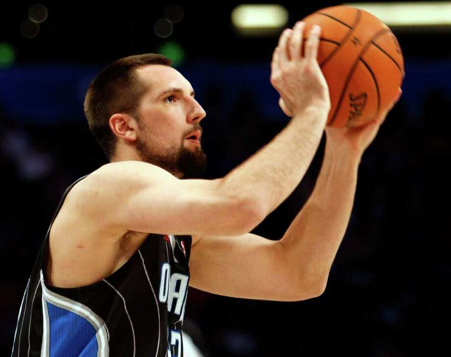 Orlando Magic's Ryan Anderson shoots during the NBA All-Star Three-Point Shootout basketball competition in Orlando, Fla., Saturday, Feb. 25, 2012. (AP Photo/Lynne Sladky) Photo: Associated Press