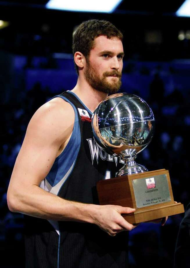 Minnesota Timberwolves' Kevin Love holds the NBA All-Star Three-Point Shootout basketball trophy after winning the event in Orlando, Fla., Saturday, Feb. 25, 2012. (AP Photo/Lynne Sladky) Photo: Associated Press