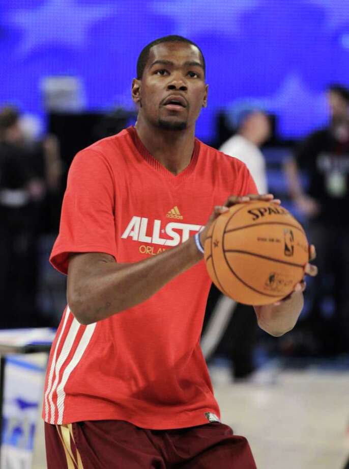 Western Conference's Kevin Durant, of the Oklahoma City Thunder, warms up for the NBA All-Star basketball game, Sunday, Feb. 26, 2012, in Orlando, Fla. (AP Photo/Chris O'Meara) Photo: Associated Press