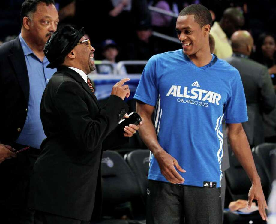 Eastern Conference's Rajon Rondo, of the Boston Celtics, right, speaks with filmmaker Spike Lee, left, in front of the Rev. Jesse Jackson before the NBA All-Star basketball game, Sunday, Feb. 26, 2012 in Orlando, Fla. (AP Photo/Chris O'Meara) Photo: Associated Press