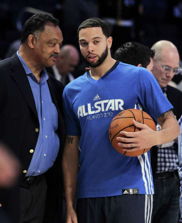 The Rev. Jesse Jackson speaks to Eastern Conference's Deron Williams, of the New Jersey Nets, before the NBA All-Star basketball game, Sunday, Feb. 26, 2012, in Orlando, Fla. (AP Photo/Chris O'Meara) Photo: Associated Press
