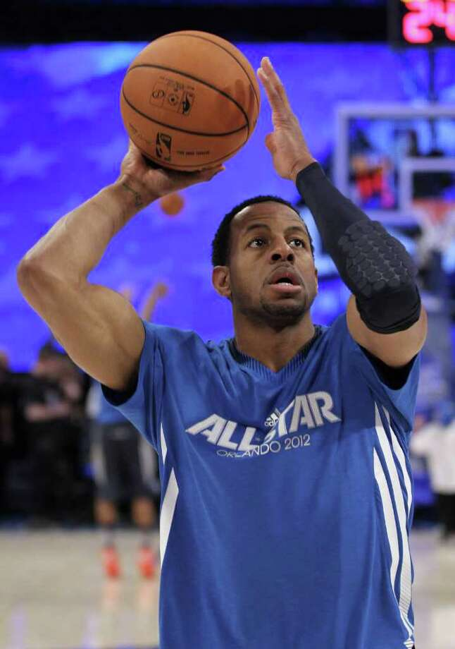 Eastern Conference's Andre Iguodala, of the Philadelphia 76ers, warms up for the NBA All-Star basketball game, Sunday, Feb. 26, 2012, in Orlando, Fla. (AP Photo/Chris O'Meara) Photo: Associated Press