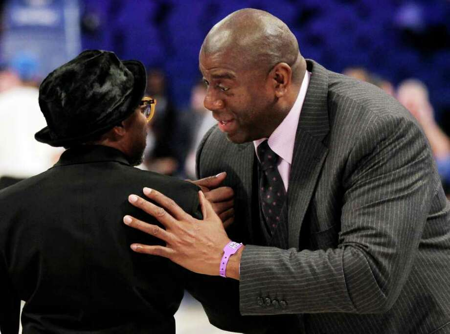 "Hall of Famer Earvin ""Magic"" Johnson, right, speaks to filmmaker Spike Lee before the NBA All-Star basketball game, Sunday, Feb. 26, 2012, in Orlando, Fla. (AP Photo/Chris O'Meara) Photo: Associated Press"