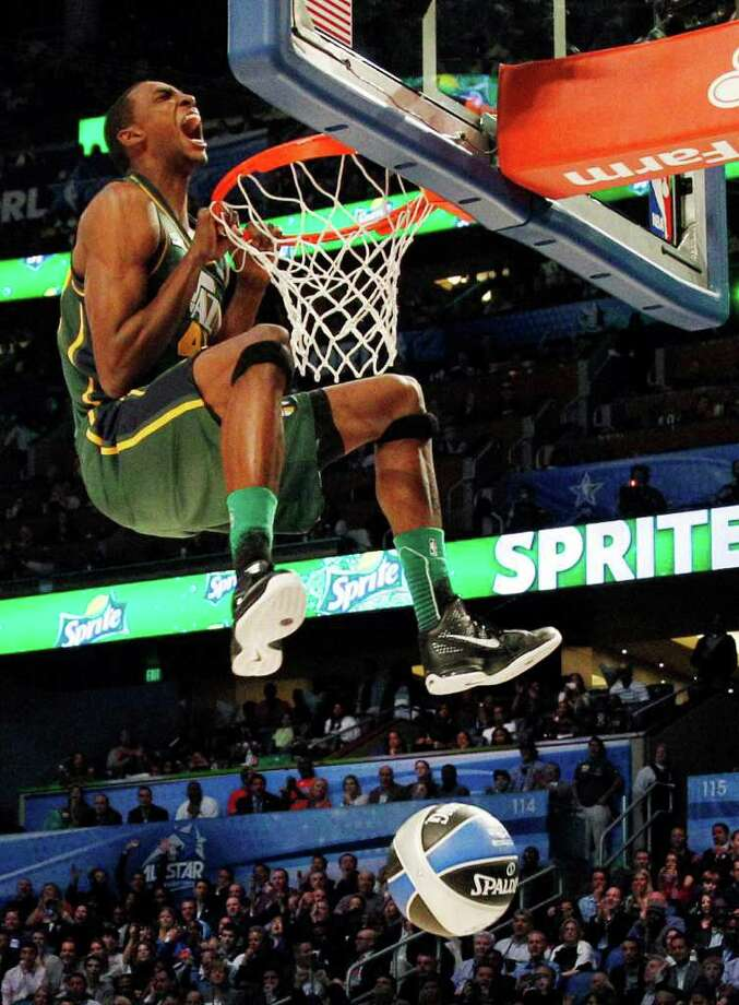 Utah Jazz's Jeremy Evans hangs onto the rim after his attempt during the NBA basketball All-Star Slam Dunk Contest in Orlando, Fla., Saturday, Feb. 25, 2012. Evans earned 29 percent of 3 million text message votes cast by fans to win the competition. (AP Photo/Lynne Sladky) Photo: Associated Press