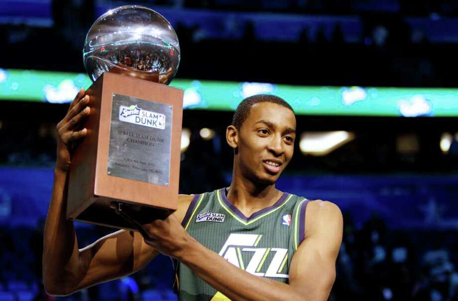 Utah Jazz's Jeremy Evans holds up the trophy after winning the NBA basketball All-Star Slam Dunk contest, Saturday, Feb. 25, 2012, in Orlando, Fla. (AP Photo/Lynne Sladky) Photo: Associated Press