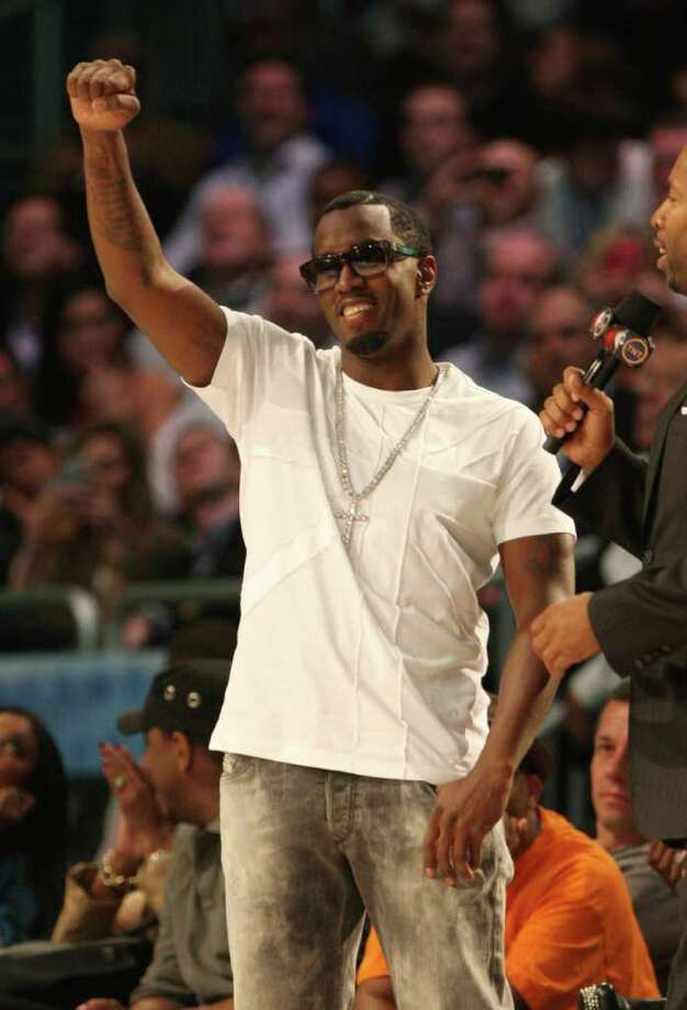 P. Diddy gestures during the NBA basketball All-Star Slam Dunk Contest in Orlando, Fla., Saturday, Feb. 25, 2012.(AP Photo/Lynne Sladky) Photo: Associated Press