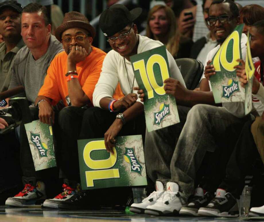 Filmmaker Spike Lee, left and singer P. Diddy, right, enjoy the NBA basketball All-Star Slam Dunk Contest in Orlando, Fla., Saturday, Feb. 25, 2012.(AP Photo/Lynne Sladky) Photo: Associated Press
