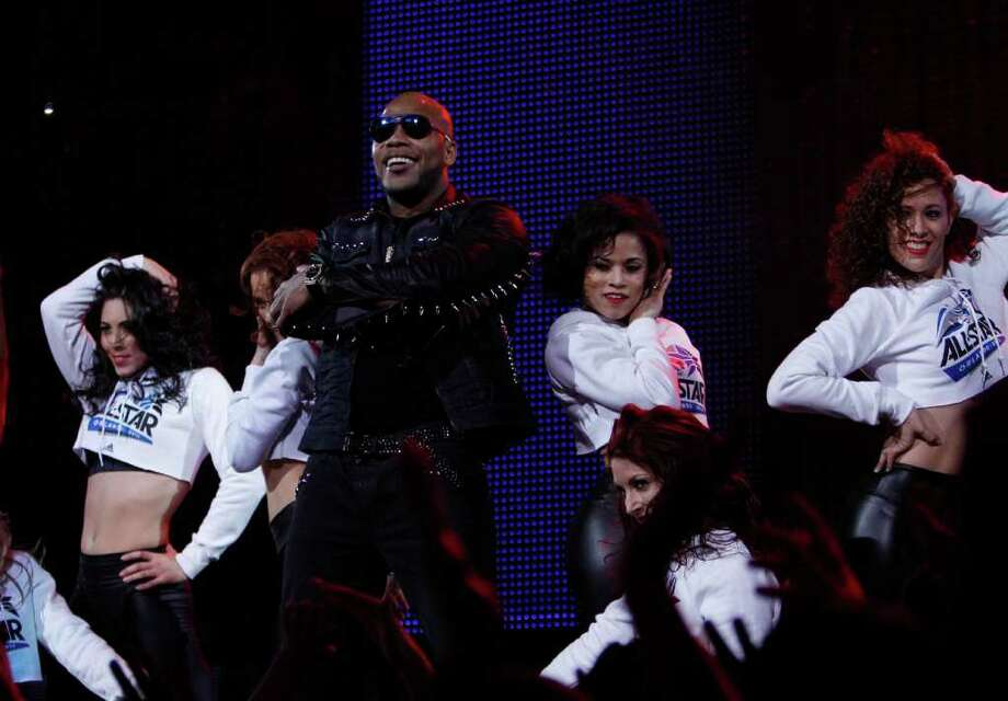 Lead singer Tramar Dillard of the group Flo Rida perform during the NBA basketball All-Star Slam Dunk Contest in Orlando, Fla., Saturday, Feb. 25, 2012.  (AP Photo/Lynne Sladky) Photo: Associated Press