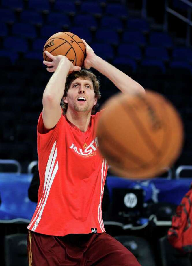 Western Conference's Dirk Nowitzki, of the Dallas Mavericks, warms up before the NBA All-Star basketball game, Sunday, Feb. 26, 2012, in Orlando, Fla. (AP Photo/Chris O'Meara) Photo: Associated Press
