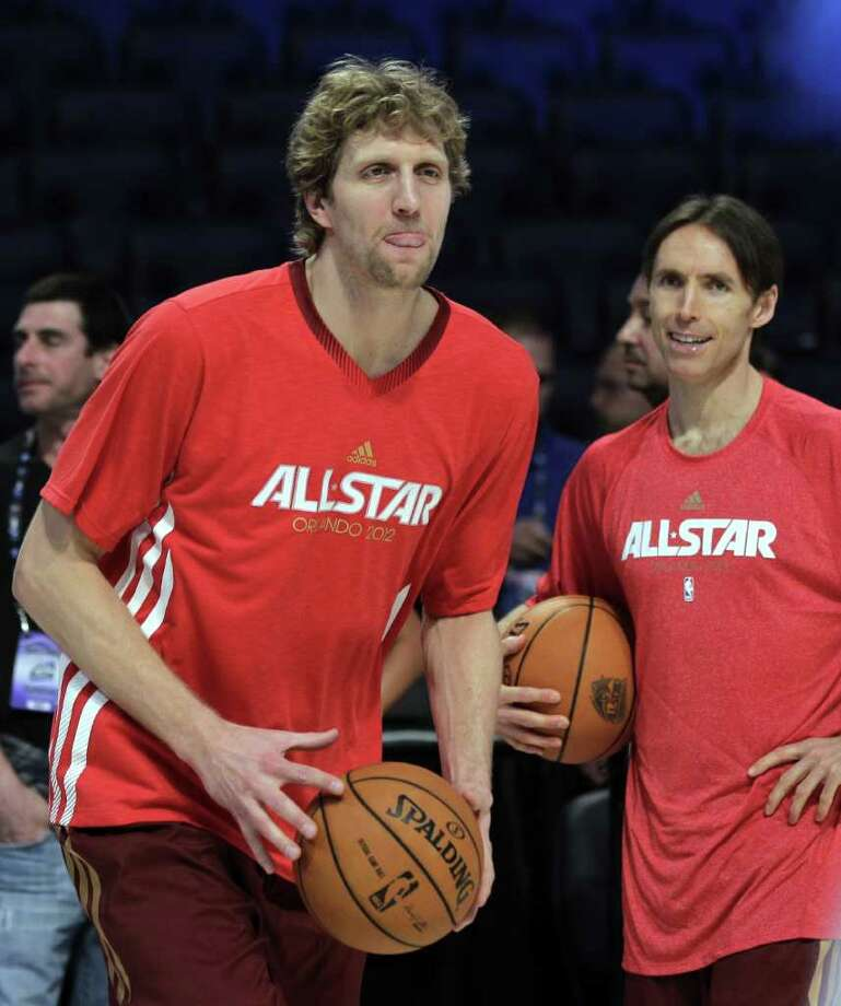 Western Conference's Steve Nash, right, of the Phoenix Suns, and Dirk Nowitzki, of the Dallas Mavericks, warm up forthe  NBA All-Star basketball game, Sunday, Feb. 26, 2012, in Orlando, Fla. (AP Photo/Chris O'Meara) Photo: Associated Press