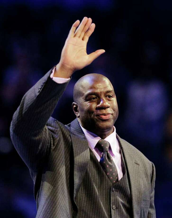 "Hall of Famer Earvin ""Magic"" Johnson waves as he is introduced before the start of the NBA All-Star basketball game, Sunday, Feb. 26, 2012, in Orlando, Fla. (AP Photo/Chris O'Meara) Photo: Associated Press"